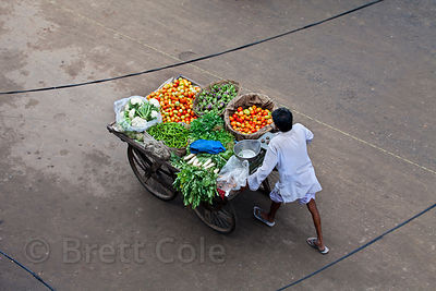 Aerial view of a man pushing a vegetable cart in Jaipur, Rajasthan, India