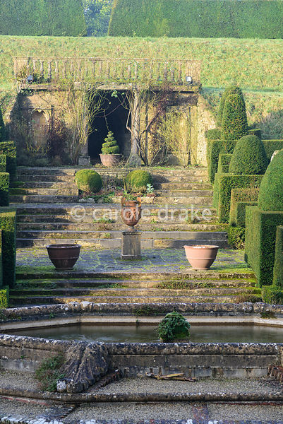 Fountain Court with central fountain, urns and clipped yew topiary. Mapperton, Dorset