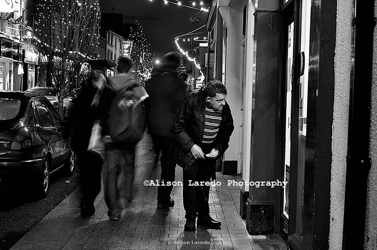 Jack Blaine wandering around Castlebar just before Christmas 2010. Passersby passing by.Photo Alison Laredo