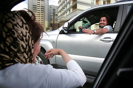 Iran-Teheran, Exchanging phone numbers.  Iranian youth drive around town and according to the luxursious cars of young men gi...
