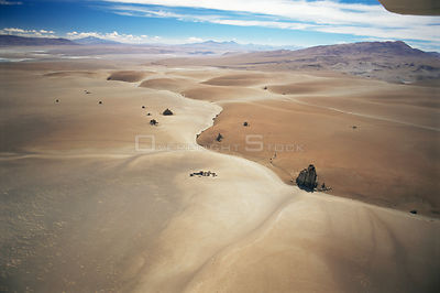 Aerial view of barren landscape and a solitary dirt road through the altiplano at 4500m, Bolivia, South America