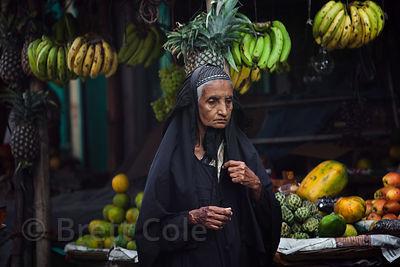 Elderly Muslim woman at a market in Metiabruz, Kolkata, India.