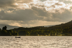 A fishing boat on the Lake of Menteith within the  Loch Lomond and Trossachs National Park.