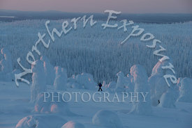 A lone Photographer Searches for perfect Tykkylumi Scene in Intense minus 25C cold and a biting wind.