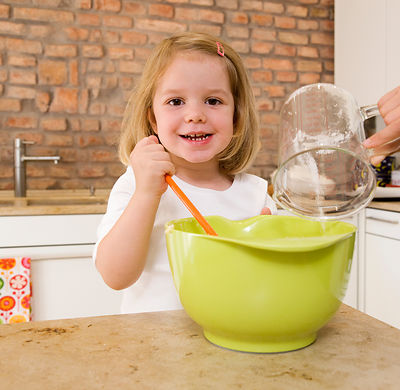 girl mixing ingredients in bowl