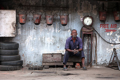 Perfect still life painting of a worker at a gas station in Kumartoli, Kolkata, India. Kolkata is amazing for these kinds of ...