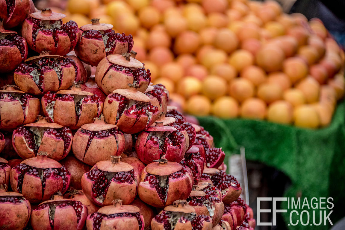 Pomegranates and Oranges For Sale At A Bazaar In Iraq