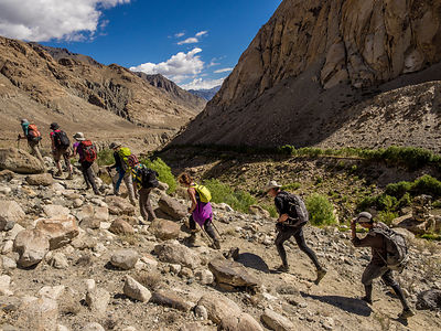 A group of tourists hike a mountain in Ladakh.