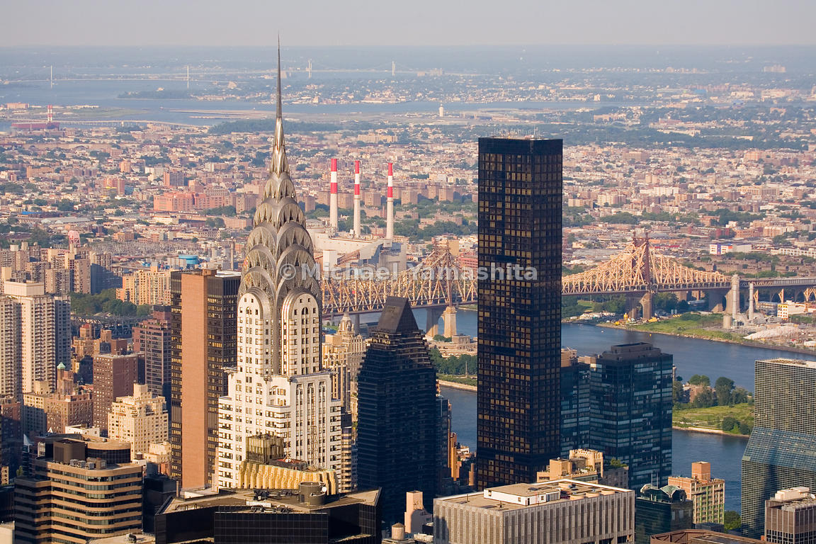 The graceful arches of the Chrysler Building are a dramatic counterpoint to the stark, black Trump World Tower.  Manhattan, N...