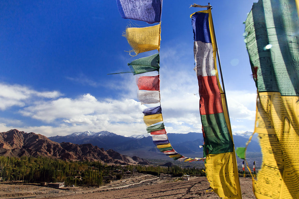 Prayer flags in Saboo Village with a view of Stok Kangri, Ladakh, India