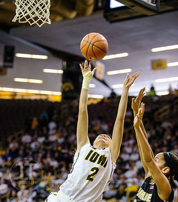 Iowa's Aly Disterhoft (2) shoots as Purdue's Whitney Bays (32) defends during the first half of play at Carver-Hawkeye Arena ...