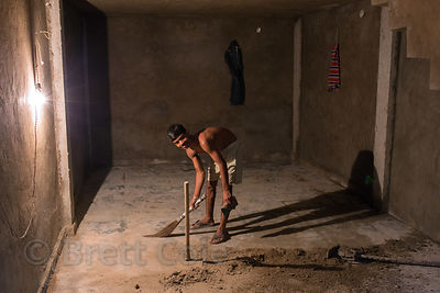 Construction worker at night in the Paharganj area of Delhi, India