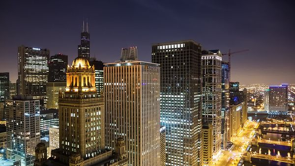 Bird's Eye: Moving Shot Looking Over A Mix of Classic Modern & Art Deco High-rises and the Chicago River Corridor at Night