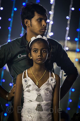 A girl watches festivities during Durga Puja, Babughat, Kolkata, India