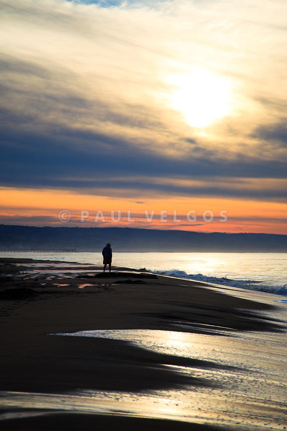 Person Walking on Newport Beach During Sunrise Photo
