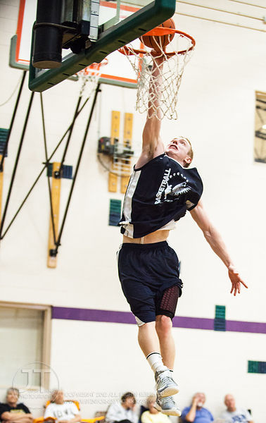 Iowa's Mike Gesell goes up for a dunk during Primetime League play at the North Liberty Recreation Center on Sunday July 14, ...
