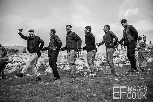 Kurdish Men Dancing On A Mountain For Newroz