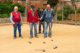 Men playing bocce ball in Barcelona, Spain