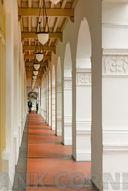 SINGAPORE - OCTOBER 07, 2016: A covered passage leading to the world famous Long Bar at Raffles Hotel in Singapore.