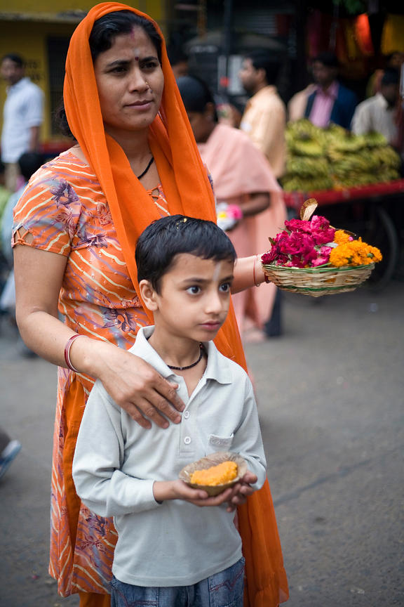 India - New Delhi - A boy and his mother queue with other devotees.