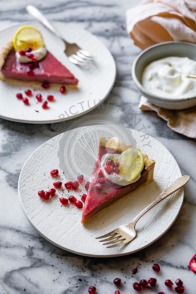 Pomegranate Curd Tart on a marble background