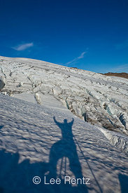 The photographer with arms raised in triumph (it was a long hike for him!) looking across Easton Glacier, Mt. Baker–Snoqualmi...