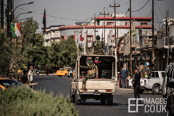 Hashd al Shaabi troops drive through the turkman area of Kirkuk the day after they took the city from the Kurdish Peshmerga i...