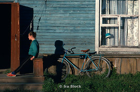 A young girl with a bike in Siberia.