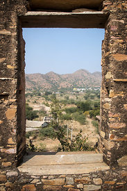 Aravali mountains and Thar desert seen through a window in an old abandoned fort above Budha Pushkar, Rajasthan, India