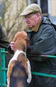 A supporter greets a Cottesmore hound
