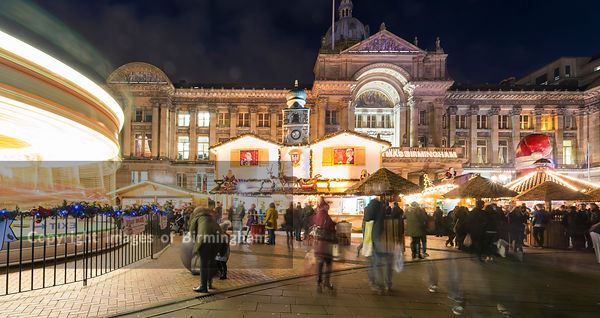 Shoppers at the German Market, Birmingham, England. Victoria Square and Council House.