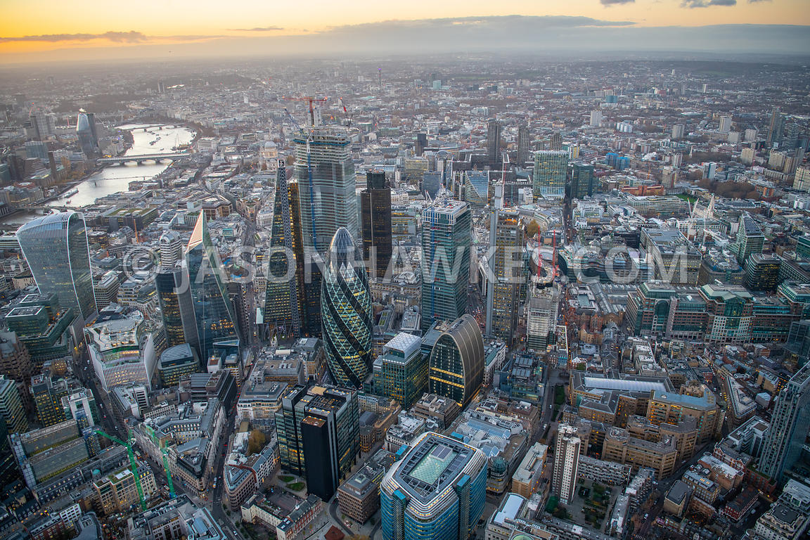 Dusk aerial view of the City of London, London. 17 St Helens Place, 30 St Mary Axe, 100 Bishopsgate, Bevis Marks, Bishopsgate...