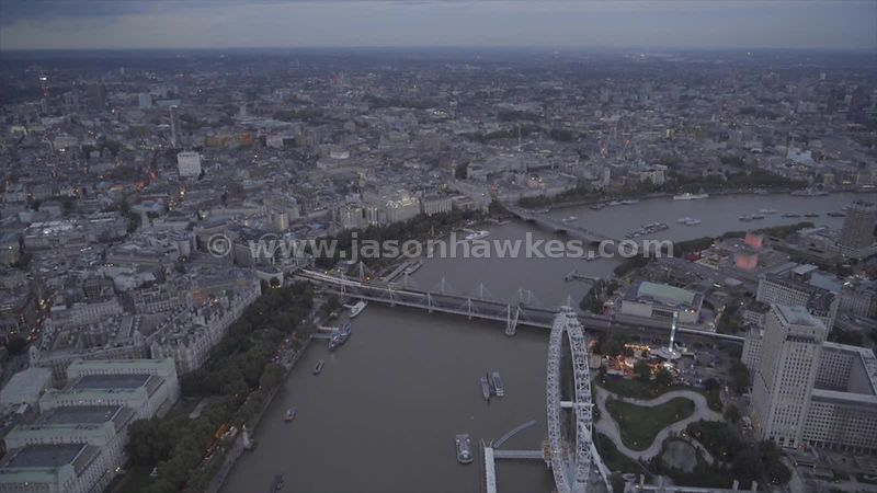 Aerial footage of the River Thames as it flows through Central London at dusk