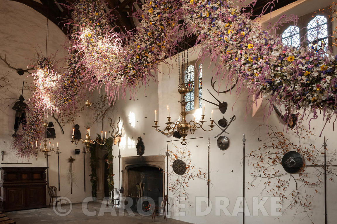 60' long dried flower garland made from over 30,000 dried flowers and grasses inserted into a pittosporum base haning in the ...