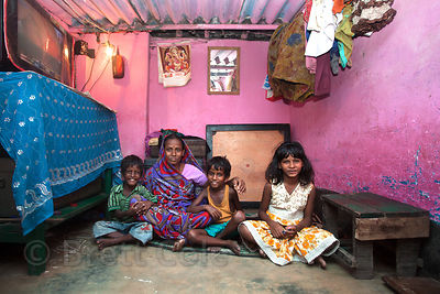 A family in their modest home in the Fakir Bagan area of Howrah, sister city to Kolkata, India. Many homes in Kolkata are onl...