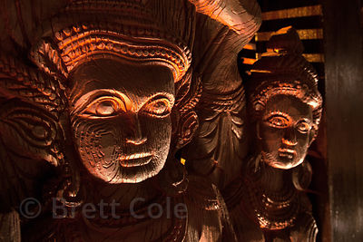 Candle-lit masks at a Kerala-themed Durga Puja pandal in the Lake Gardens area of Kolkata, India.