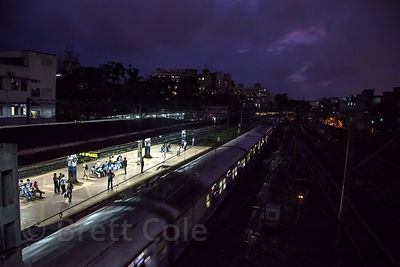 Trains at night near the Mahim Junction Station, Mumbai, India.
