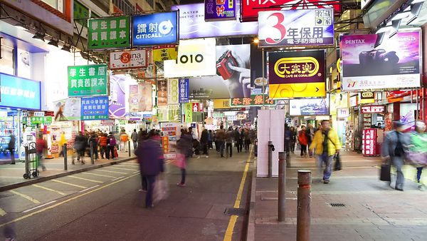 Close Up: Fluorescent Ad Cluttered Pedestrian Streets & Night