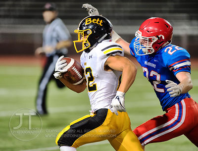 Bettendorf's Mason Morris (22) breaks a run as Cedar Rapids Washington's Lincoln Riley (22) gives chase during the first half...