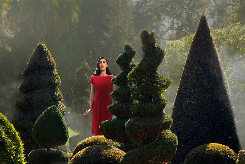 woman in topiary garden with fog