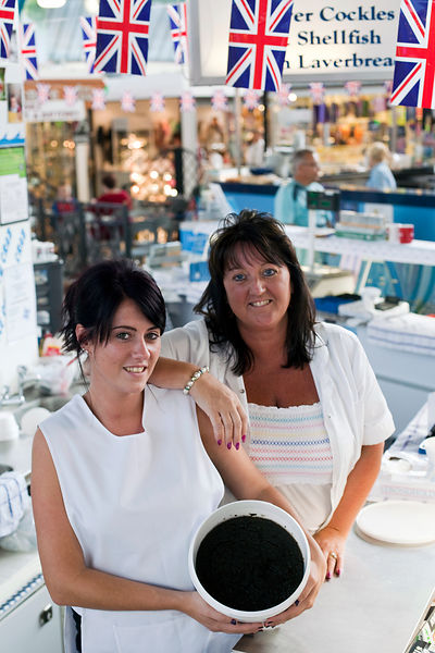 UK - Swansea - Jo Watts and her niece, Kirtsyselling seafood and laverbread on the family stall in Swansea Market for generat...