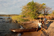 dugout canoes lying on a fishing beach, lake Niassa, Mozambique