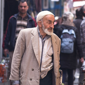 Bearded man walking in street close to the spice market, Istanbul