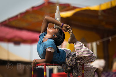 A dalit girl does a contortion act for no one at the Pushkar Camel Fair, Pushkar, Rajasthan, India. Such girls are deprived a...