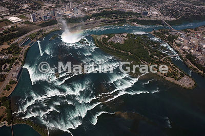 Niagara Falls from the air, showing (from left) the rapids at the outflow of Lake Erie north-west over Canadian Horseshoe Fal...