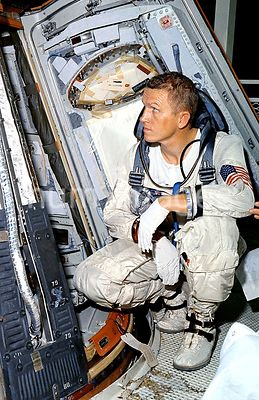 (25 Oct. 1965) --- Astronaut Frank Borman, command pilot for the Gemini-7 spaceflight, looks over the Gemini-7 spacecraft dur...