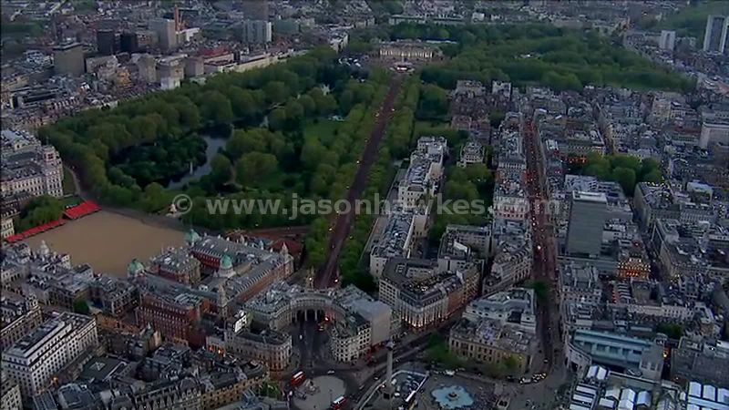 Aerial footage of Buckingham Palace and Trafalgar Square at dusk, Westminster, London