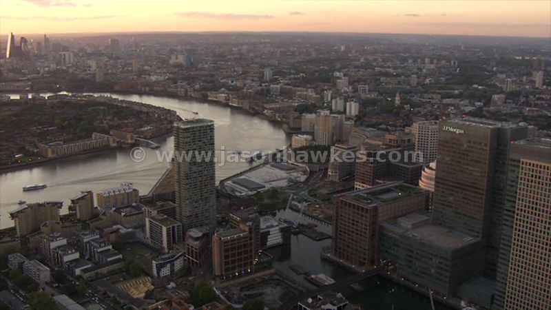 Aerial footage of the Isle of Dogs and the River Thames at sunset, London