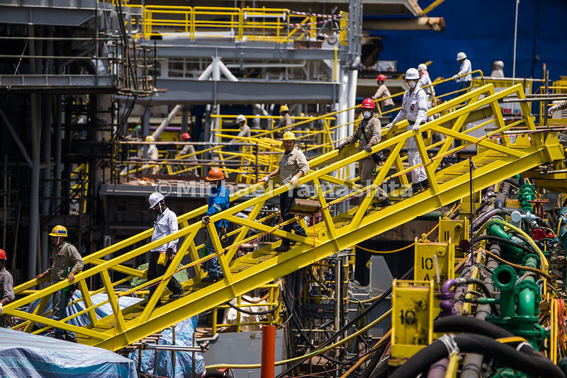 Workers disembark from the rig via the gangway for lunch.