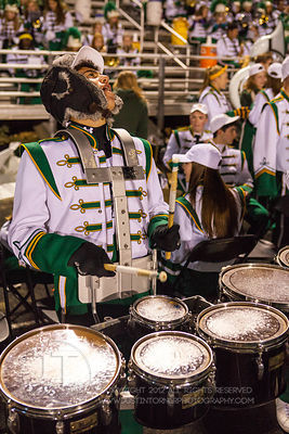 Iowa City West High Marching Band member Cameron Braberman, a sophomore  performs between quarters during the Battle for the ...